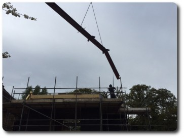Steel Beams Lifted into Place by Crane